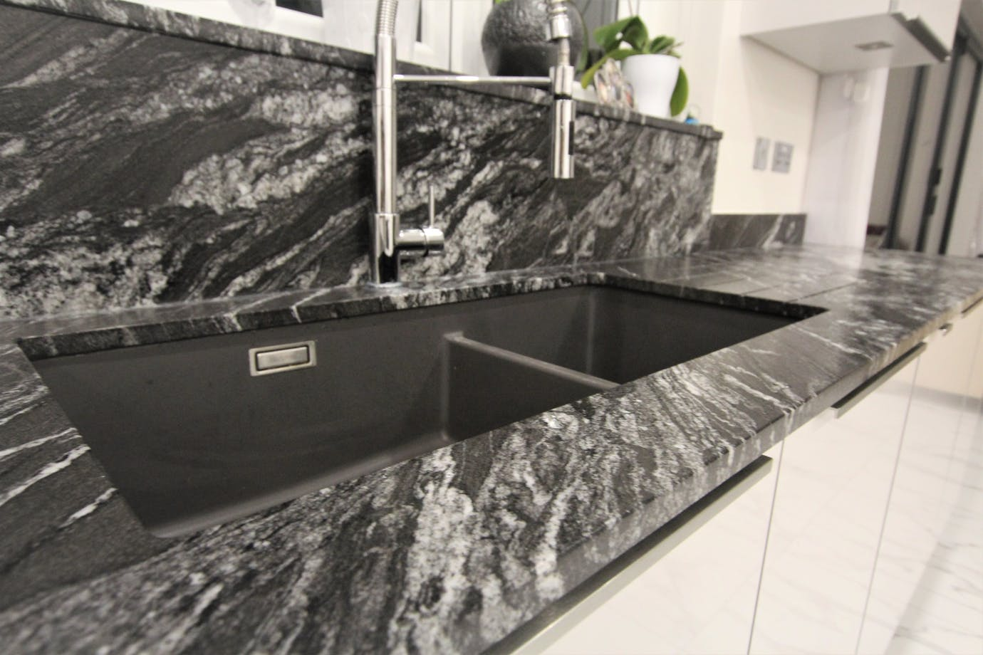 SENSA  worktop with German kitchen from Hampdens kitchens and bedrooms