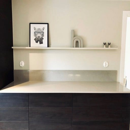 Silestone Coral Clay with black details and design items