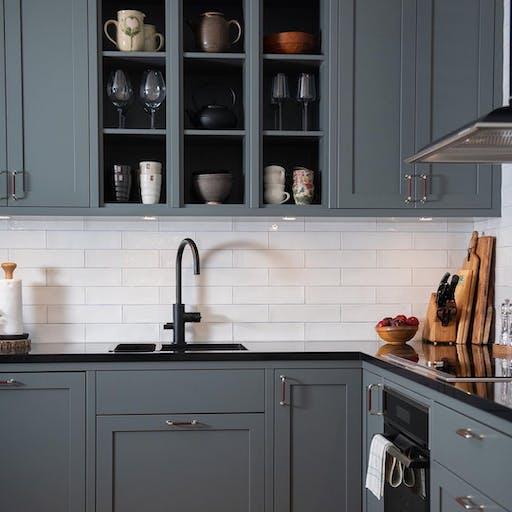 A welcoming beautiful kitchen in rustic style with Silestone Negro Tebas worktop